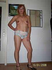 MILF dolores undresses nude at home.