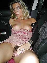 Unshaved MILF yvonne exposing her cunt in a car.