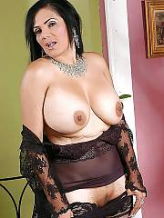 Boobed mature dark haired tianna in stocings jerking her sloppy snatch.
