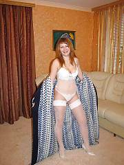 Homemade mature MILF in white stocking poses on cam.