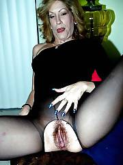 Mature MILF in black stockings touching and massaging her wet pussy.