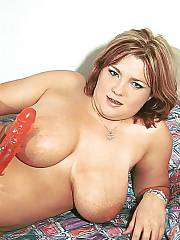 Busty fat lady wanking