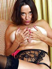 Boobed mature mother poses nude and masturbates on cam.