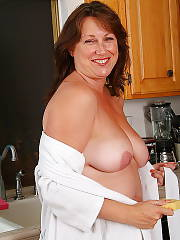 Hot mature girlie having joy in the kitchen.