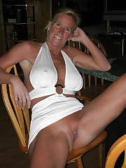 Busty mature blondie goddess strips nude on cam.