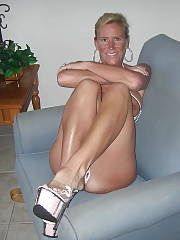 Mature light haired goddess getting naked at home
