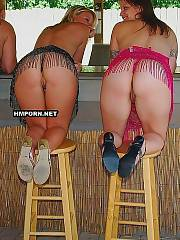 Booty mature ladies takes panties off demonstrate their great nude butts and vaginas at the pool outdoors