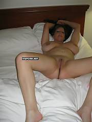 Busty black haired mamma posing nude at home, spreading legs wide to show her amazing cunt, playing with huge natural boobs and teasing husband for penetrate - private sex pictures