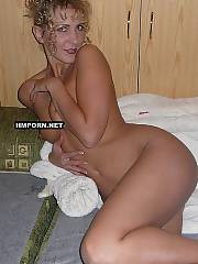 Homemade porn - pretty curly light haired MILF housewife laying on bed, teasing husband and getting fucked hard in doggy style sex position