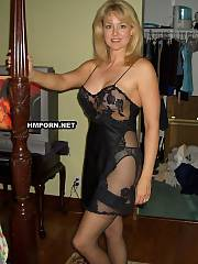 Nice mature housewife getting dressed in her various sexy lingerie and posing for husband, teasing him and playing with twat before crazy fuck - homemade sex pictures
