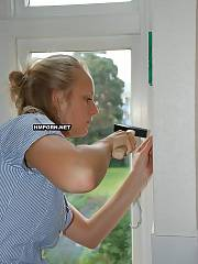 Sweet young wifey repairing window at home