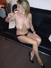 Huge busty mature drinking wine