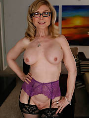 Hot blondie mature Nina Hartley poses in wonderful lingerie