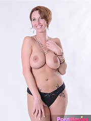 Big boobed mature flashes her huge boobies