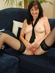 Milf at home rubbing her cunt