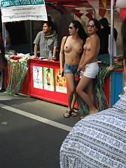 Topless mature Asians in public