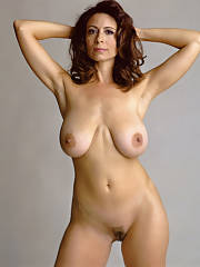 Mature brunette with large natural breasts