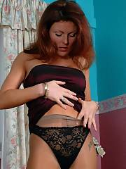 Sexy MILF in pantyhose and black string