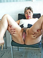 Latin mature mamma slut in the office