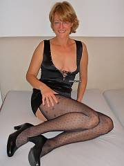 German Mature with there torn tights