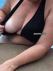 Wife flashing at our neighborhood pool