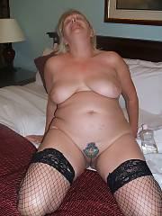 Wife strips for some hotel apartment fun, the tattoo is a fairly recent addition