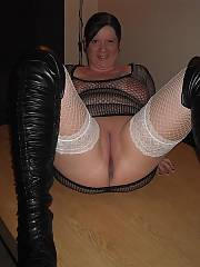 Thick bitch mother trying to be hot in a see-thru outfit and big boots. i guess everyones definition of hot is different.