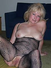 Light haired mother with an incredibly pink pussy, it helps that shes wearing those nylons for better contrast
