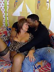 Huge MILF wifey with a huge black cock sicking out of her mouth like a cigar
