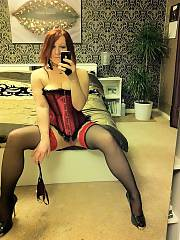 Red-haired wife in sexy outfit sent to her husband while away on business.