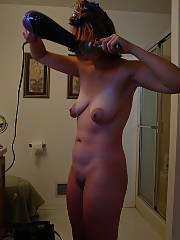 Blow drying her hair and getting lotioned up.