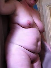 This fat mamma is showering, wish she would pose a bit more you gotta get soap under those rolls or here comes the cheese smells
