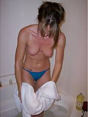 Toweling off her body and putting on some hot blue lingerie