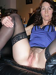 Mamma with a perfect unshaved bush posing for the camera in her best sexy underwear