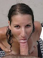 Horny girl giving a hot blow job at the beach.
