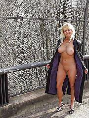 Sexy light haired mature woman posing nude above the highway.