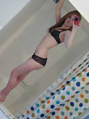 Beautiful sweet teenie taking herself a pic solo in the bathroom.