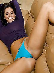 Sexy girlfriend spreading her cunt on sofa.