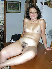 Amateur granny getting naked on the table.