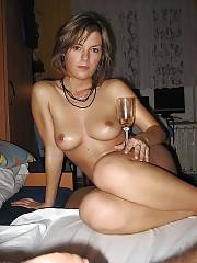 Naked girl letztes silvester enjoys drinking a glass of champaigne.