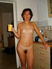 Hairy and naughty mother posing nude at home.
