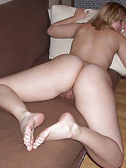 Hot girlfriend on sofa masturbating her snatch.