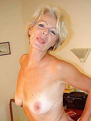Naughty mature blonde playing with her cunt and titties.
