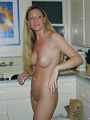 Blond nude amateur mamma having joy in the kitchen.