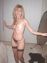Blond nude mature enjoys having fun.