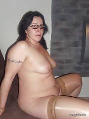 Pierced mature brunette