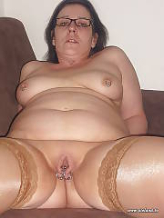Pierced mature brunette