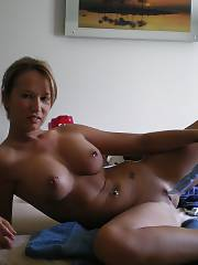 Naughty mature having fun filming and dildoing herself.