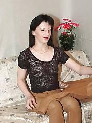 Slender brunette MILF strips on cam