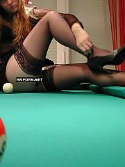 Big ass mom mistress plays billard and spreading legs to show her cunt on the billiard table